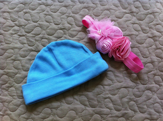I picked up these two newborn accessories at a baby boutique last week.  Only one will be needed, and I honestly have no idea which!