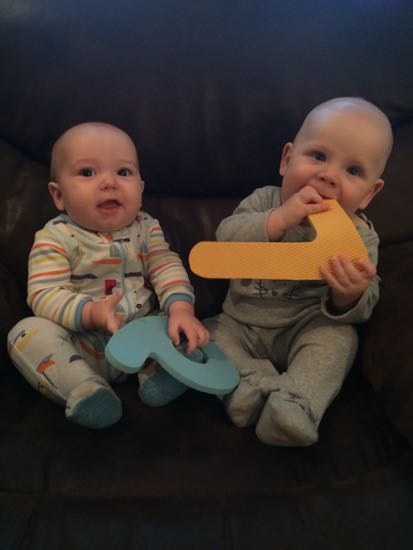 With his cousin Thomas Roy, who is 19 days younger.