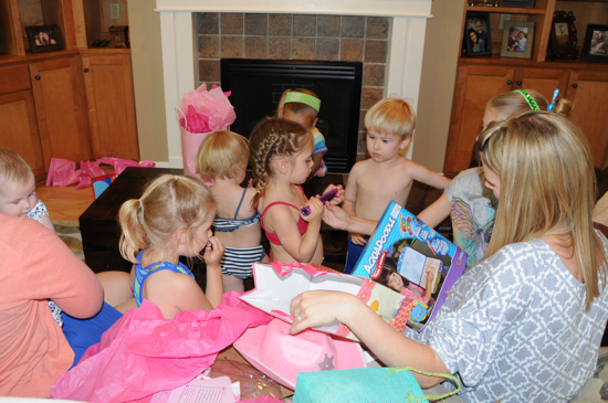Opening presents with lots and lots of little helpers.