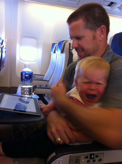 "This was the only crying fit that I remember.  I think she cried for about 5 minutes, until Oatmeal just said, ""Baby, you can't get off of this plane and no one wants to hear you cry, so you better just put your head on Daddy's shoulder and go night-night.""  I think she sputtered for another minute or so and then did just that."