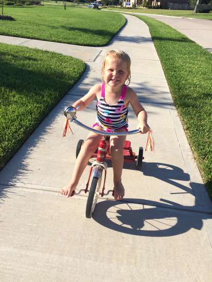 We go to the neighborhood pool almost every day, and this big kid rides her bike the entire way.