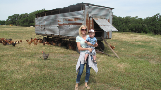 Kelly and Ben at the chicken houses.