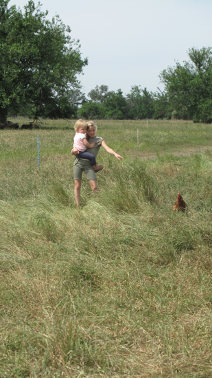 "The farmers have four ""chicks"" of their own, and they made great babysitters!  Poppyseed gets a lift across the pasture by their oldest daughter."