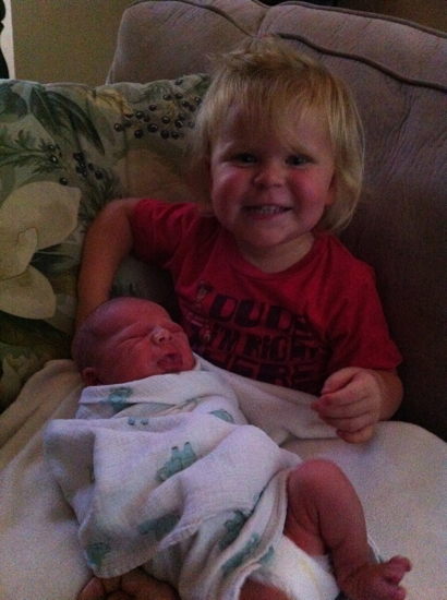 Everyone keeps asking how Poppyseed is doing with Baby Middle.  She is in LOVE with her little brother.