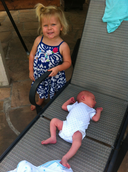Big sister with baby Middle.  He loves being outside.  The warm weather puts him to sleep immediately.