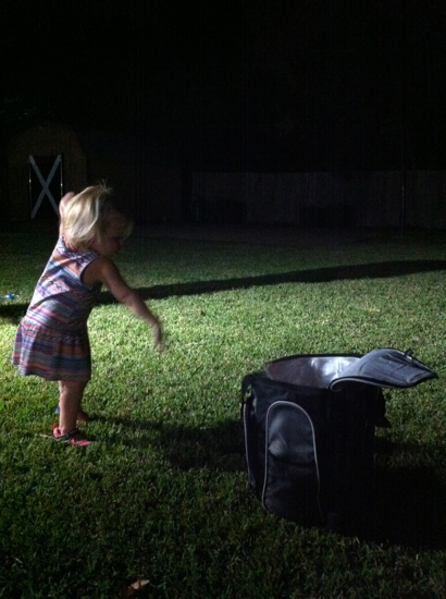 "Playing ""toss the bean bag in the cooler"" in the back yard, which she thought was so fun."