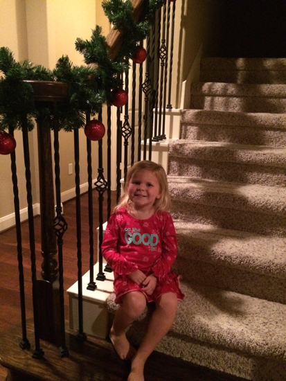 So proud of herself after helping me decorate our staircase.