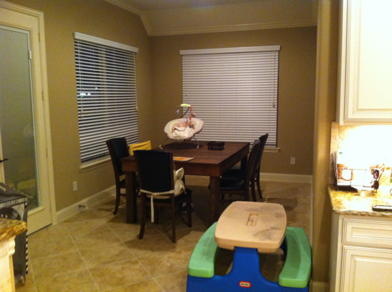 This is our breakfast room, where we eat all three meals of the day as a family.  Yes, that's a patio table (made by Oatmeal himself) standing in for a dining table.  And Poppyseed wanted her picnic table inside, too.  Why not?