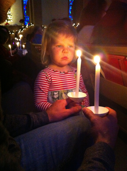 Poppyseed was very serious about lighting her candle!
