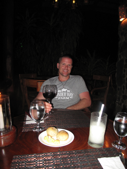 My honey enjoying a glass of wine after a day of beach hopping and exploring.