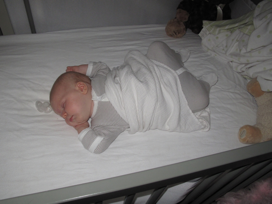 Baby Poppyseed at 3 months...busting out of her swaddle and sleeping soundly!