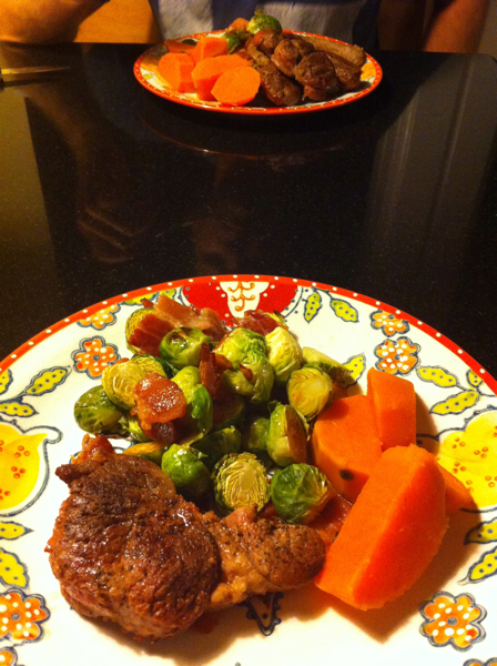Pork shoulder roast, brussells sprouts, and sweet potato.