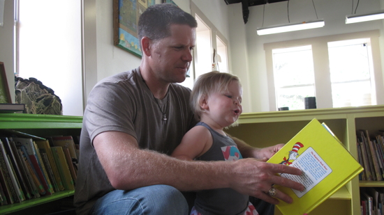 """Reading her favorite book, """"One Fish Two Fish"""" by Dr. Seuss with Oatmeal."""