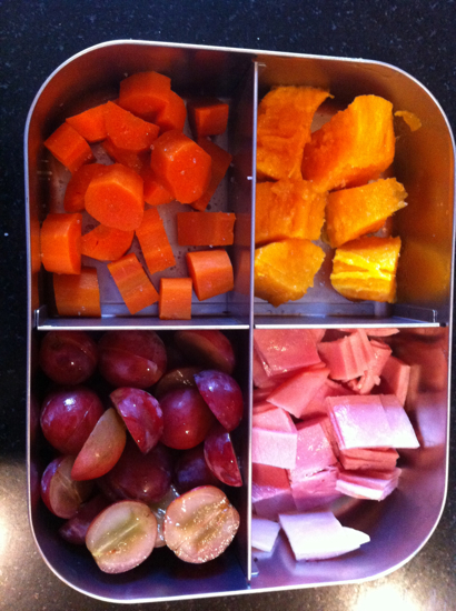 Daycare or school lunch idea:  Roasted carrots, roasted sweet potatoes, grapes, and Applegate ham.