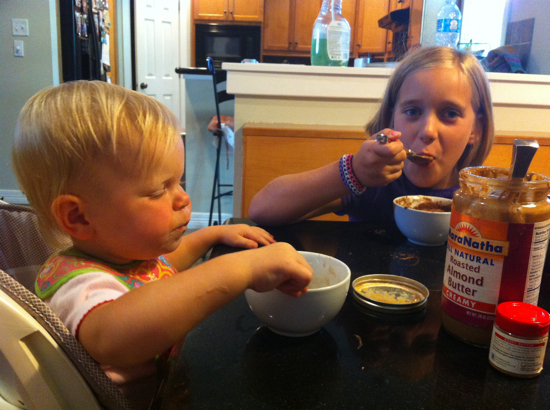Enjoying a summer treat with her cousin - homemade banana ice cream topped with almond butter.
