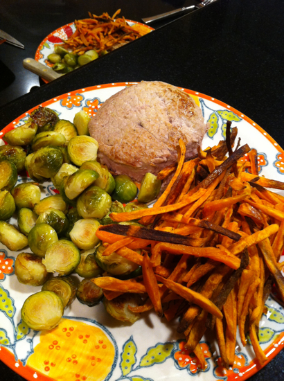 Pork chops, brussels sprouts and sweet potato fries. (Can you tell I'm really into sweet potato fries?  With a LOT of salt!)