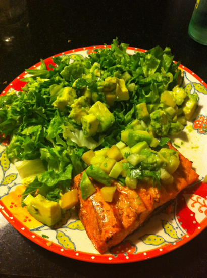 Blackened salmon with avocado salsa and fresh lettuce.