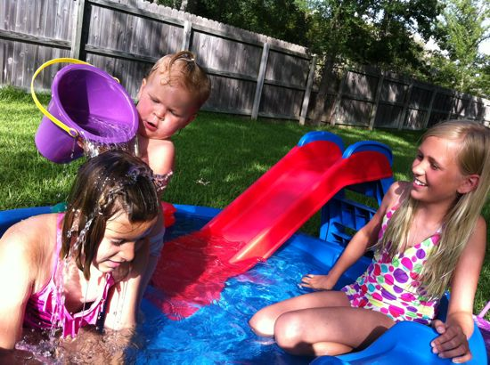 Baby pool in the back yard.... isn't cousin Eva the best sport??