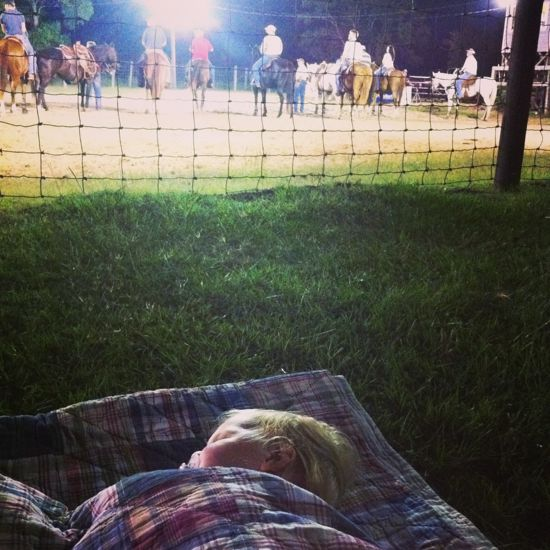 After all of the swimming and sun, all of the kids were worn out by 9pm.  Poppyseed laid down on a quilt near the arena while Oatmeal wrapped up his competition.
