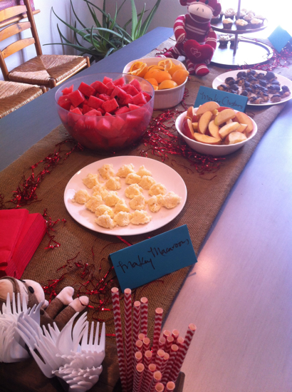 "This was the spread at a birthday party we were invited to recently.  Watermelon, oranges, apple slices, and ""Monkey Macaroons"" made of coconut oil!  Everything served was gluten free, grain free, dairy free, and totally natural!"